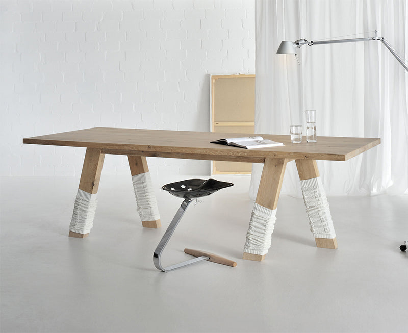 Dash table in light oak, legs wearing humorous leg warmers.