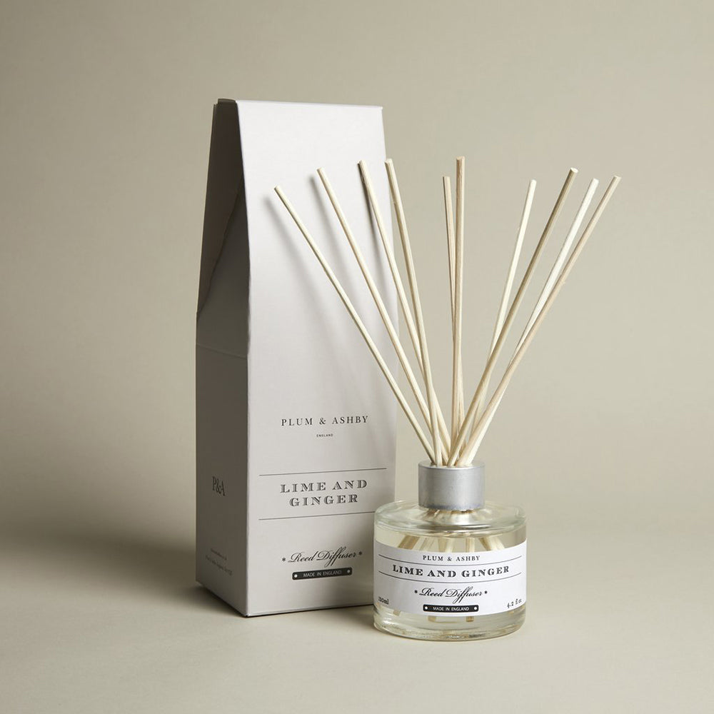 clear glass diffuser jar with natural reeds, white label and light grey giftbox.