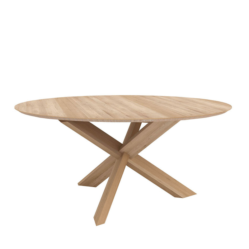 circle dining table, oak round top with a tapered edge. crossed leg pedestal