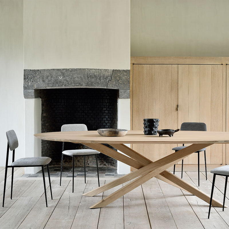 lifestyle shot of the table in use with dining chairs