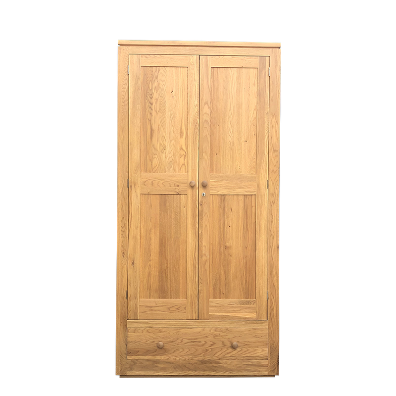 Elements oak wardrobe with two panel doors over drawer.