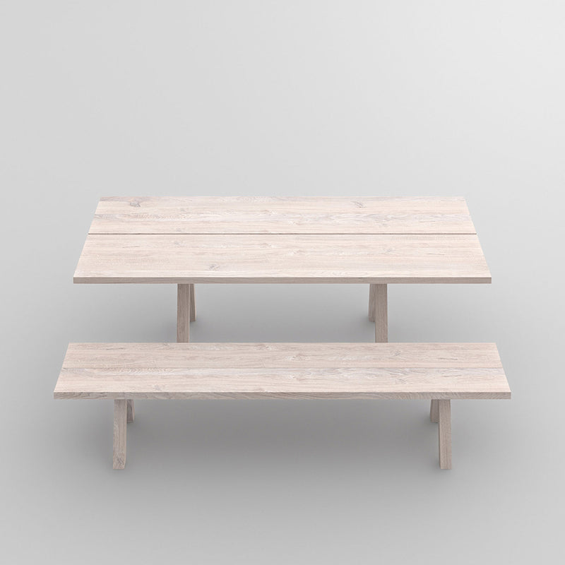 Facile oak table with trestle style legs finished in a white oil - shown with matching bench