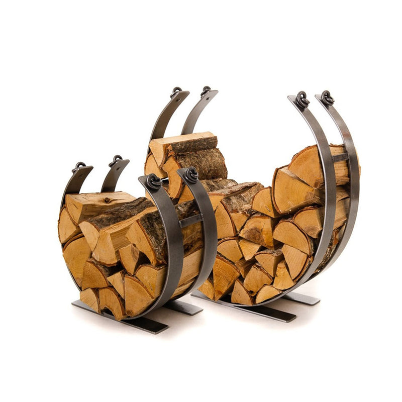 circle log holders, forged steel shown in both sizes stacked with firewood.