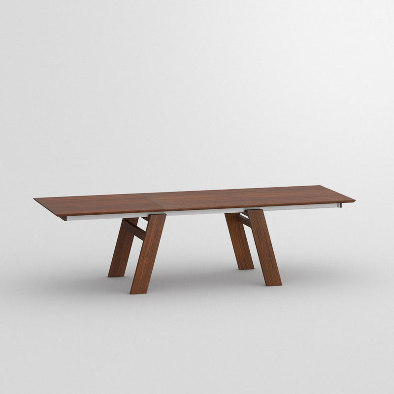 Frame walnut table side view showing tilted legs, fully extended