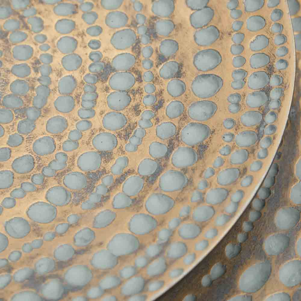 antique gold wall plate, detail of spotty pattern