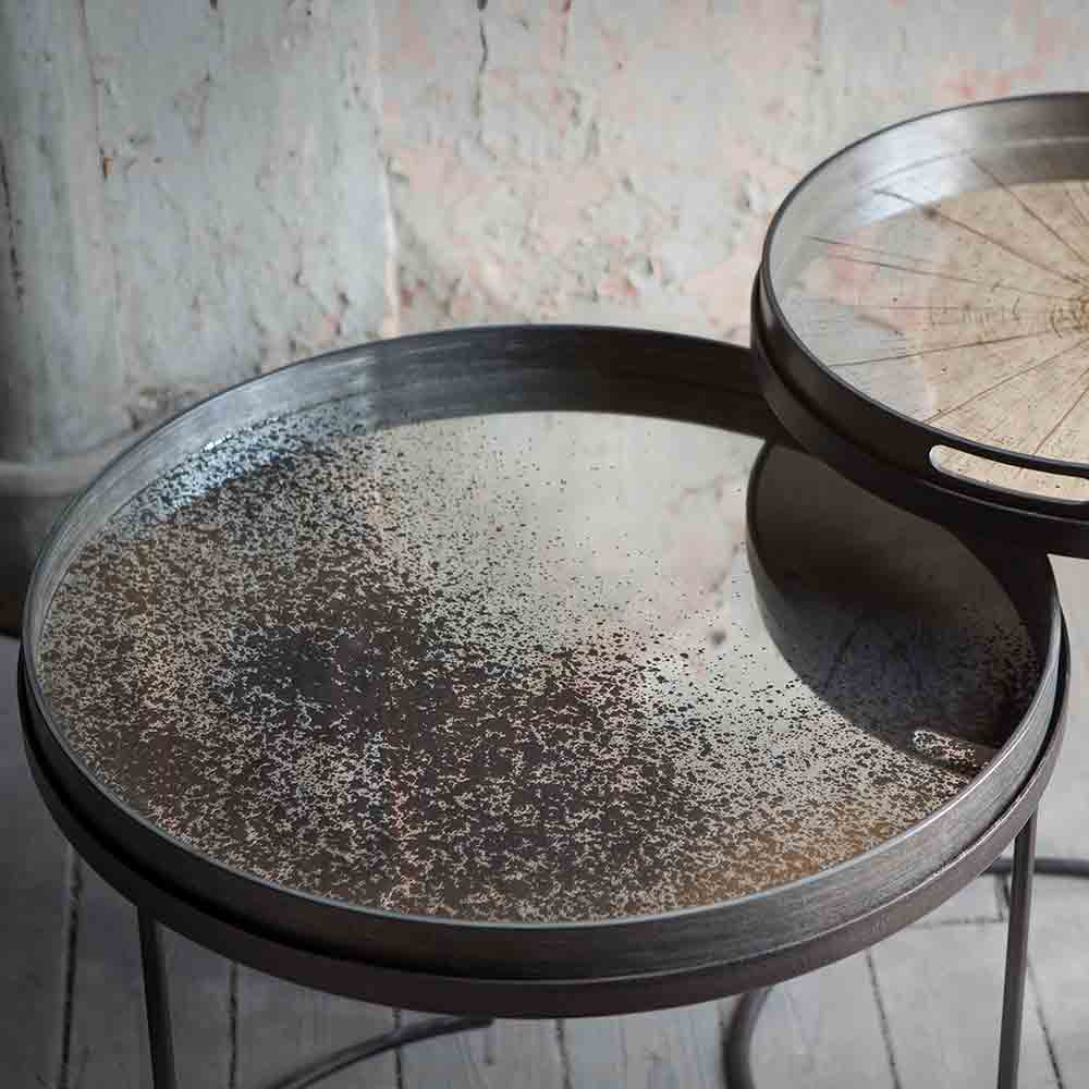 large mirrored tray with aged effect on metal circular table