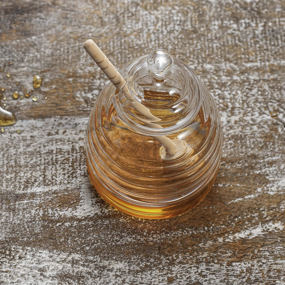 top view of glass honey pot, glass lid has a round handle