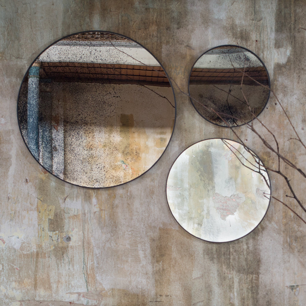 round aged mirrors shown in three sizes