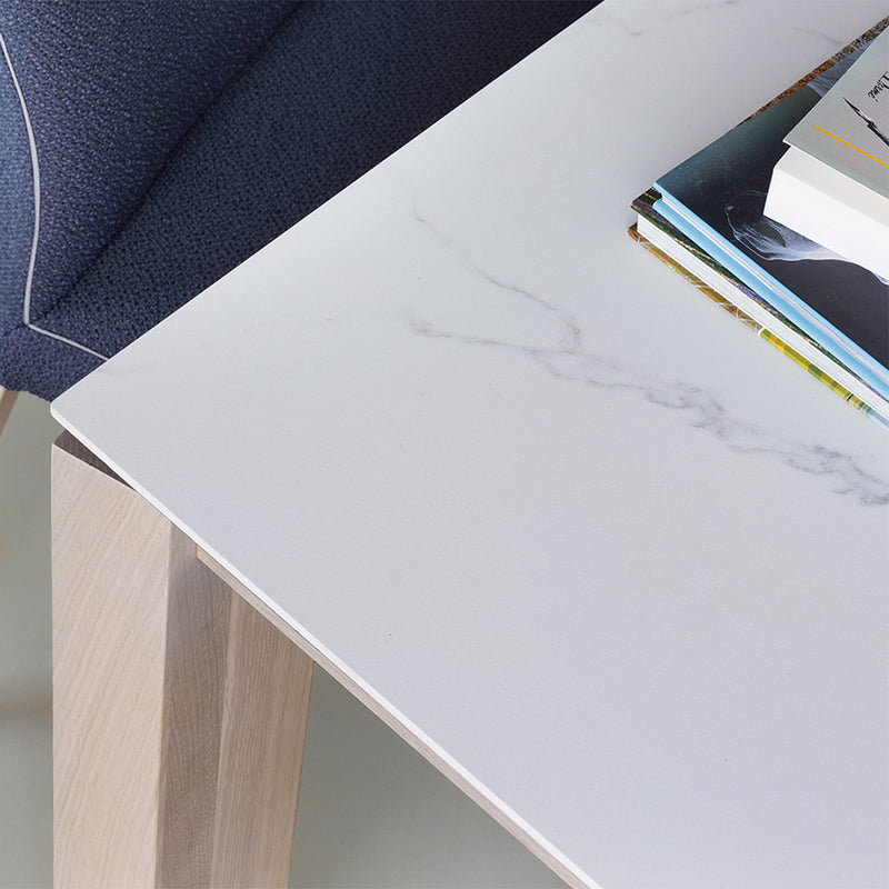 close up picture of bianco statuario ceramic tabletop on oxford 1 dining table