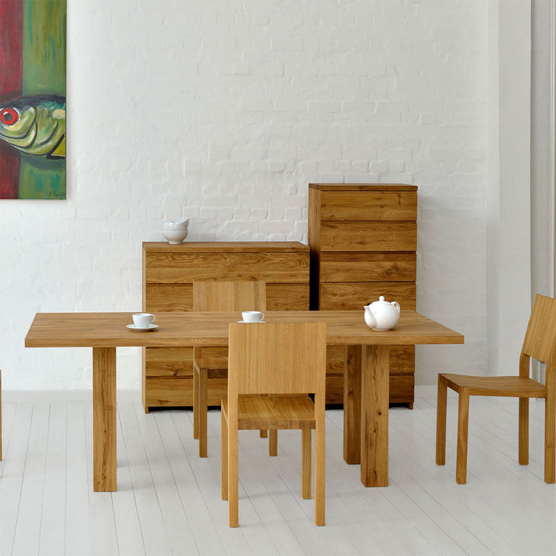 mallard  oak table shown with oak chairs in modern dining room.