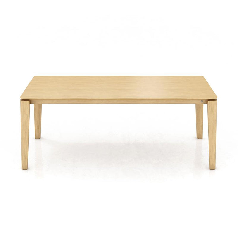 oak table with rounded tapered leg profile