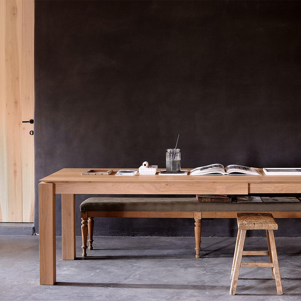 Oak Planar extending table shown in modern dining space with  bench and stool seating.