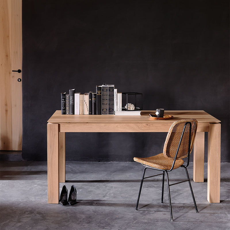 Oak planar table, shown closed, styled with books and a chair as a desk