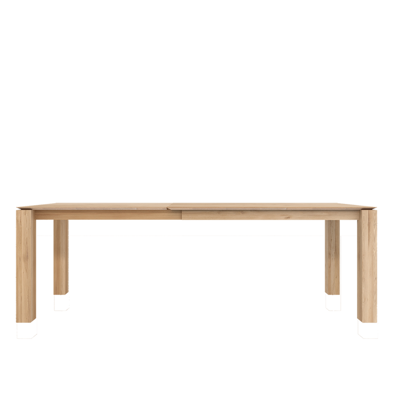 Oak planar table, shown extended, square legs remain at the corners, seating within them