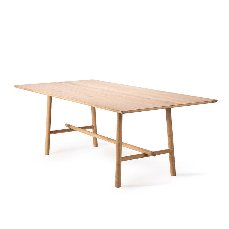 Profile dining table with rounded profile legs. Side view