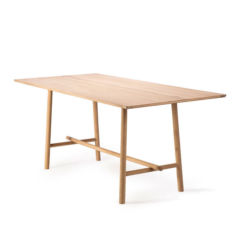 profile view of high meeting table showing the rounded profile trestle leg design