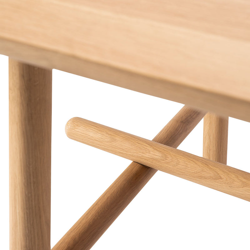 Close up detail of the profile rounded leg on the profile dining table