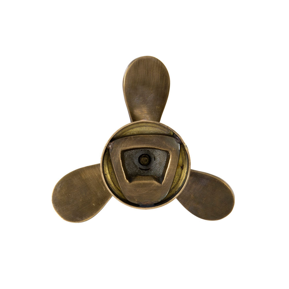 brass set of propellors shaped bottle opener ( remover in rear of propellor)