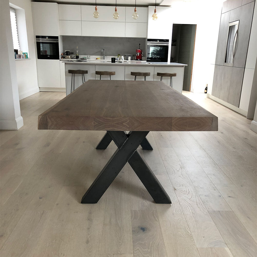 River dining table with industrial steel base in contemporary kitchen