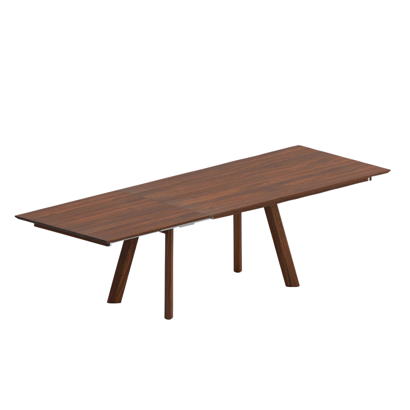 Rombi walnut dining table shown extended with 4 angled rhombic legs