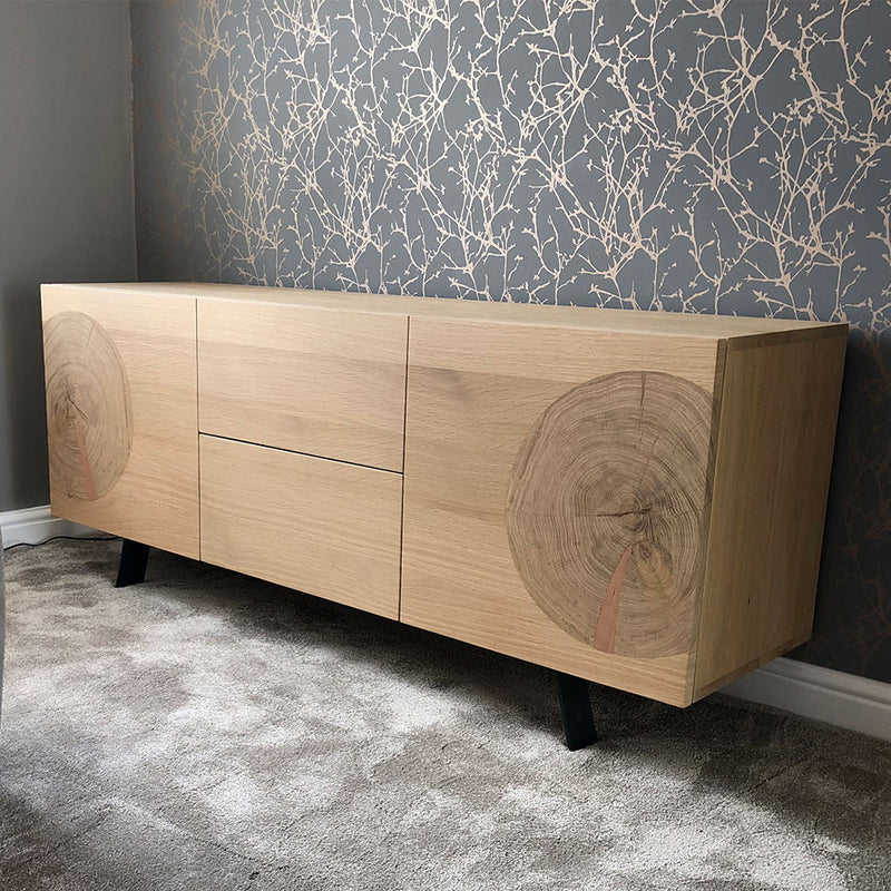 slice sideboard showing circular tree trunk detail on flat doors