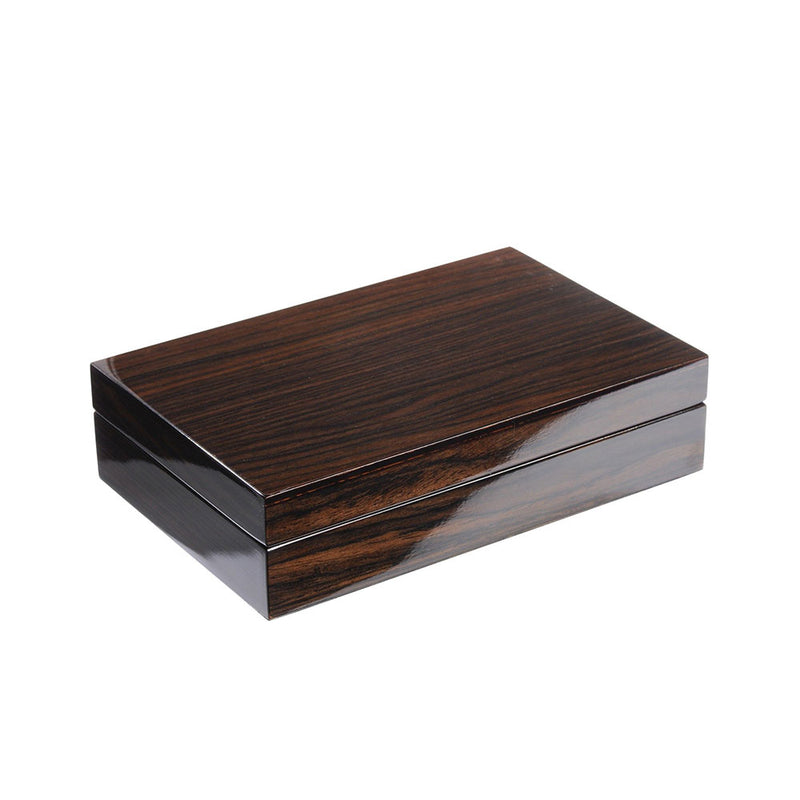 Closed box made of highly polished walnut veneer