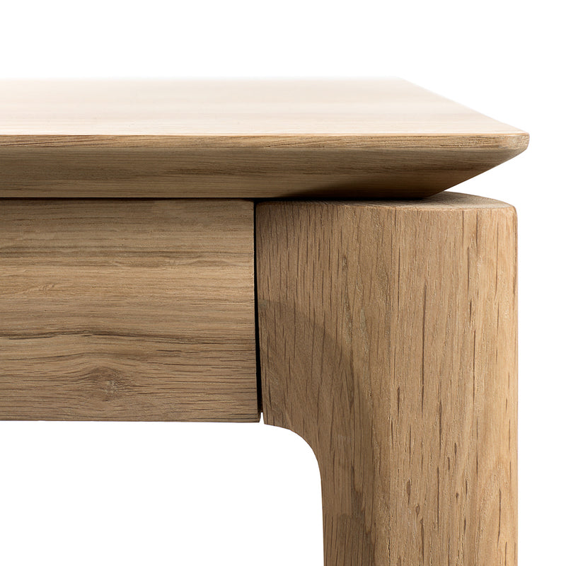 B1 oak table detail of corners, tapered edge to wood top,over rounded legs.