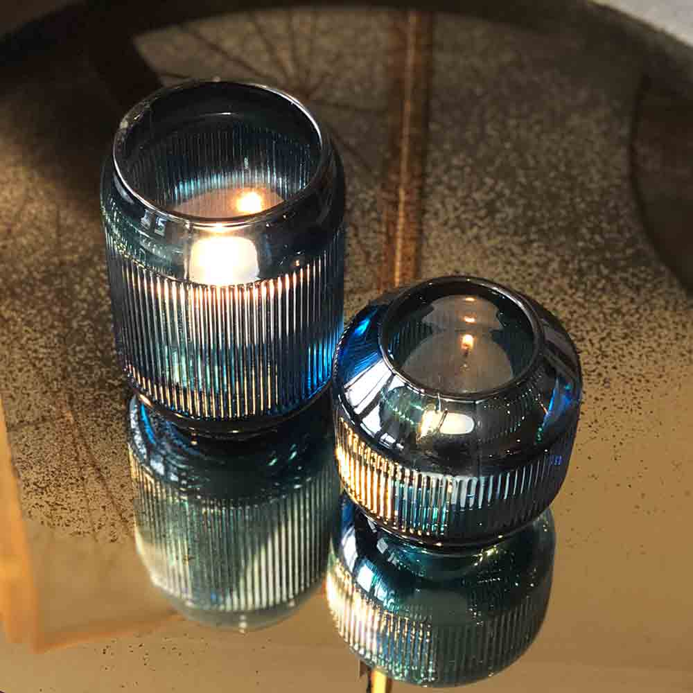 deep blue heavy glass ribbed tealight holders, small and large.