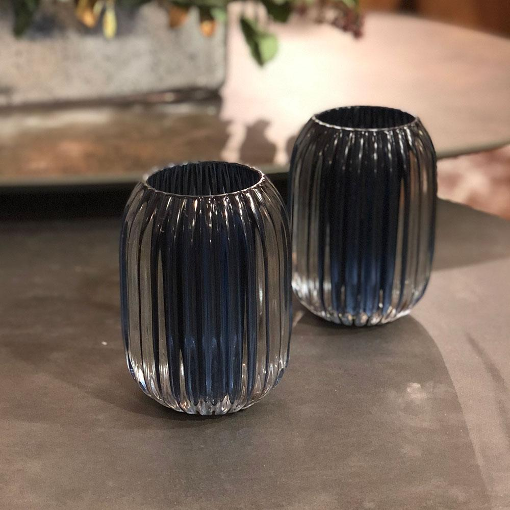 pair of ribbed glass tealight tealights in blue on the coffee table