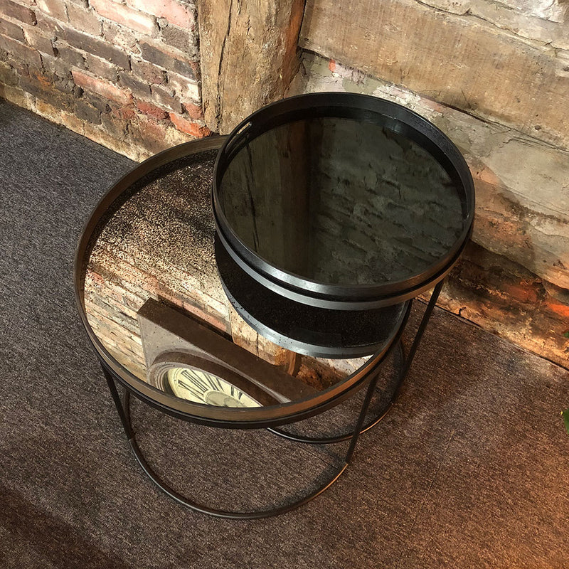 small charcoal tray and large heavy aged tray on top of stackable side table tray tables.