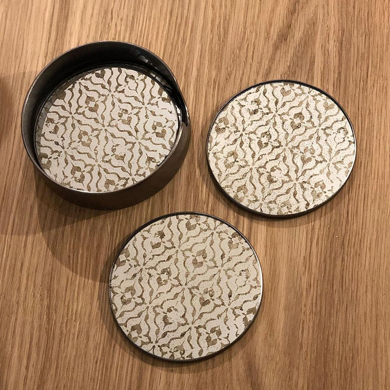 Diamond print mirror coasters. set of four round coasters in tabletop holder