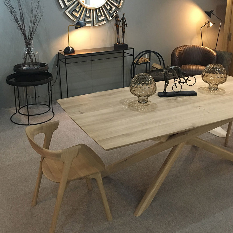 Elements rectangle oak dining table shown with wood B1 chair in a contemporary room setting.