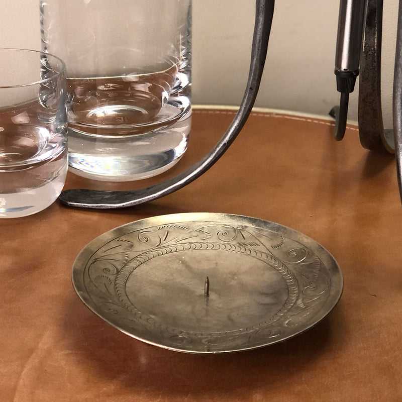 spiked candle dish with ornate etching to edge.