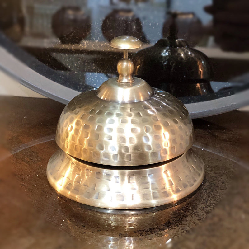 Brass hotel desk style bell, with button top, hammered effect finish