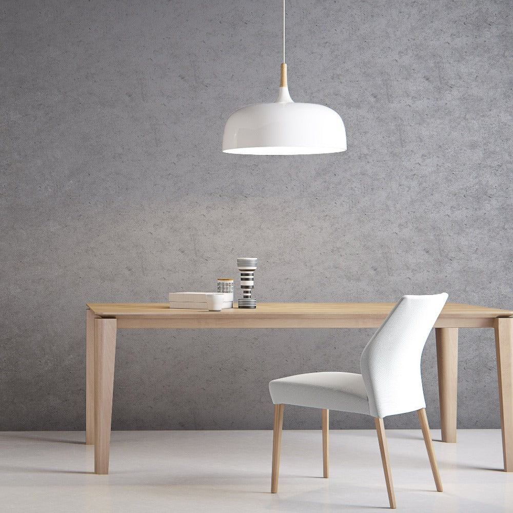 oak dining table with rounded leg profile , chair pulled up and pendant lamp over table