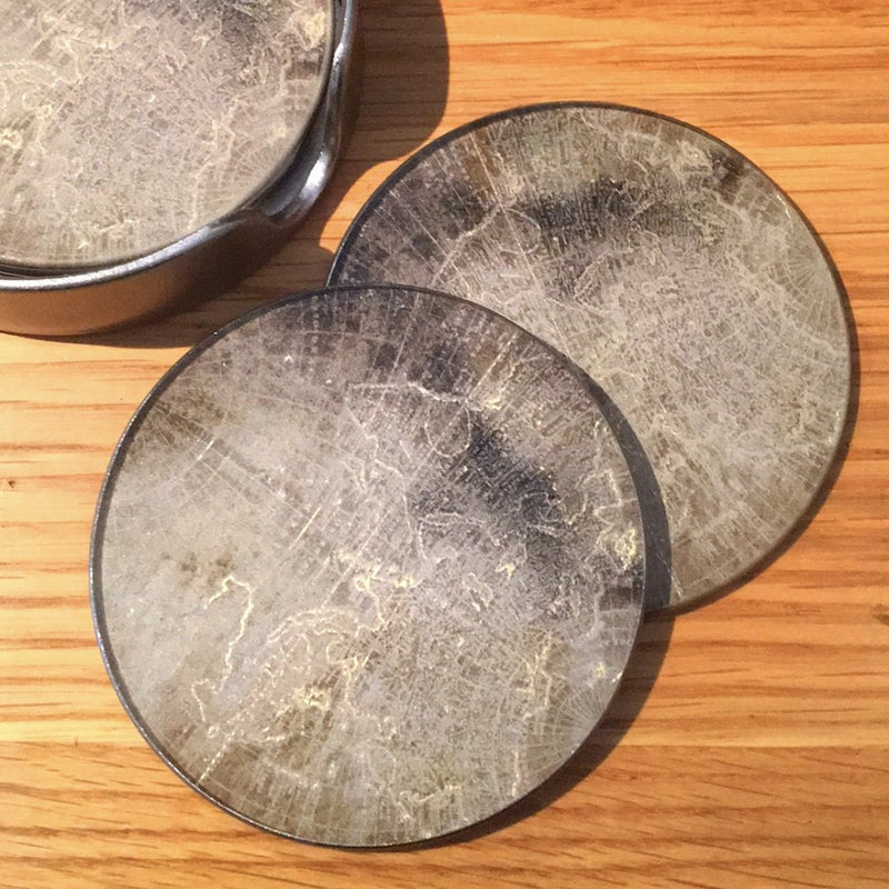 altas coasters laid on wooden table top