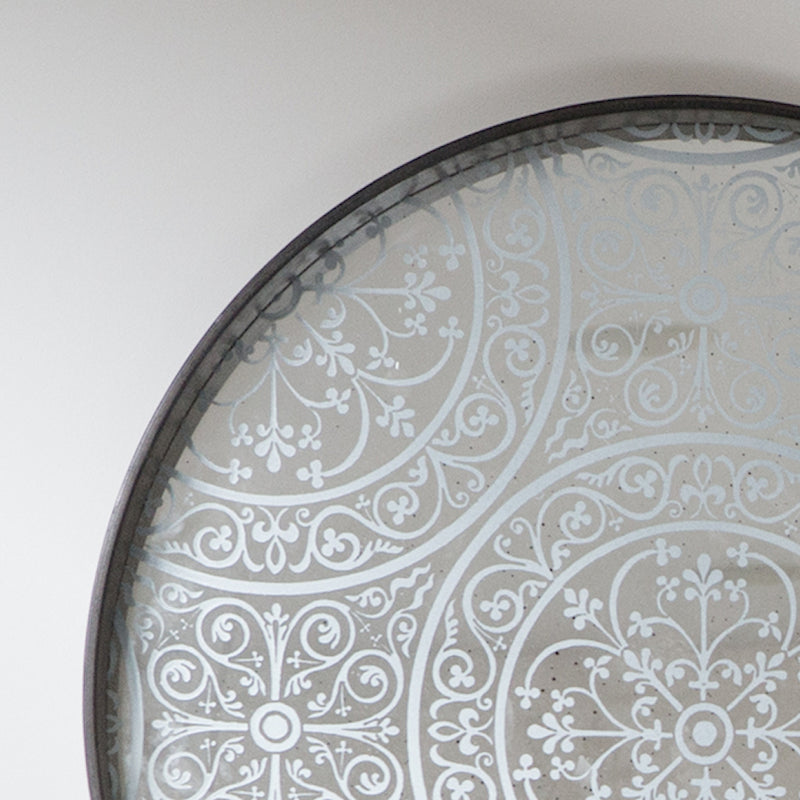 Moroccan  detail - repeat pattern over aged mirror.