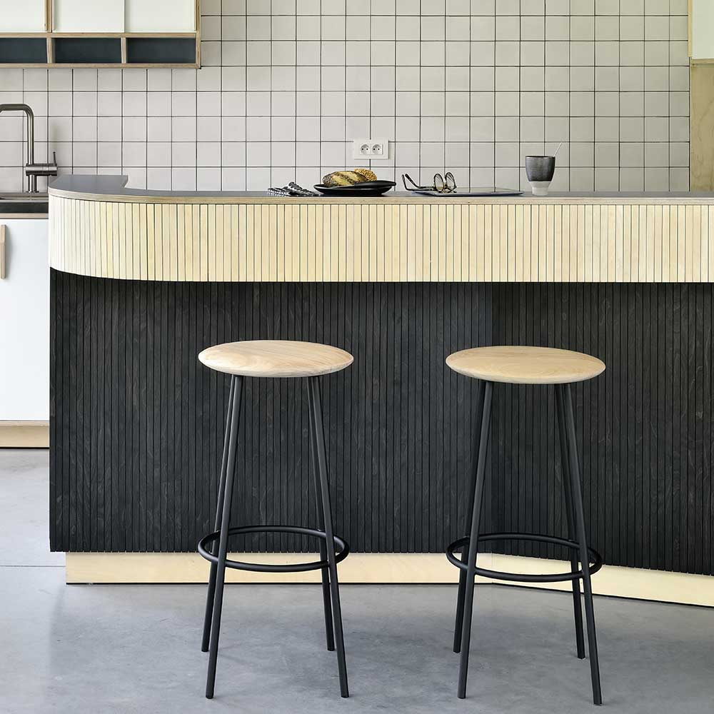 Lifestyle picture of the barretto stool at a kitchen counter