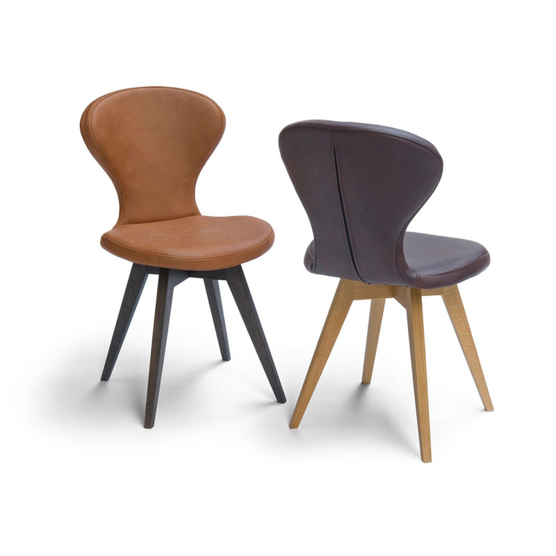 R1 dining chair bespoke options, shown in tan leather with black oak legs and black leather with natural oak legs
