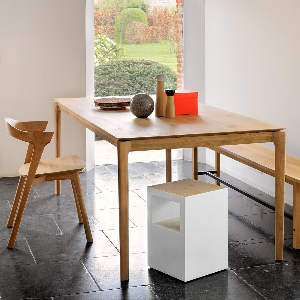 Oak B1 fixed dining table, shown in modern home with a mixture of chairs .