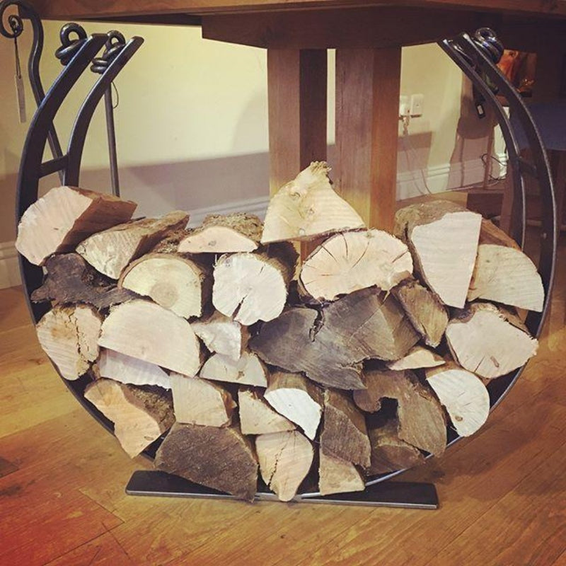 Forged metal log holder, in a circle shape for cut logs.