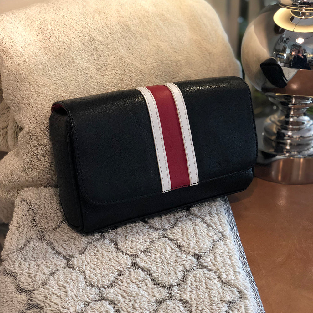 Dalton manbag black leather with a red over white stripe on the pouch flap.