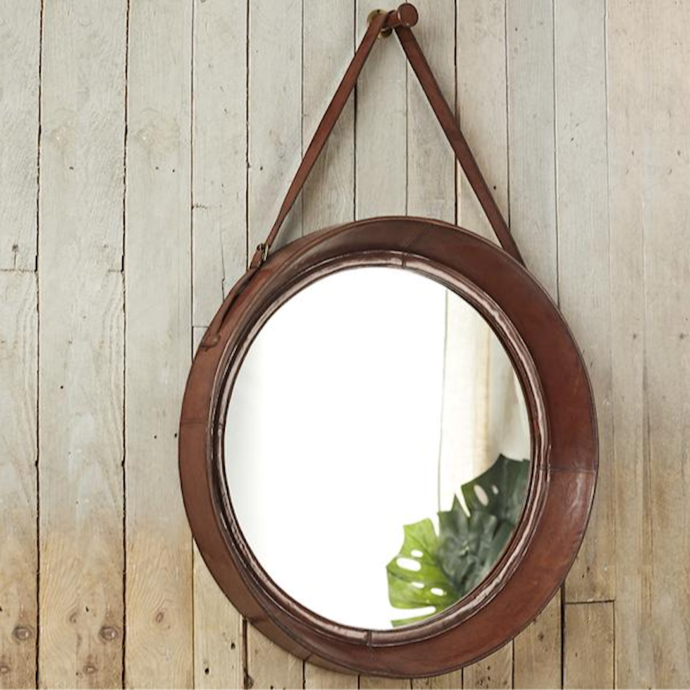 Leather Rimmed Wall Mirror with leather strap hanging from a leather covered peg.