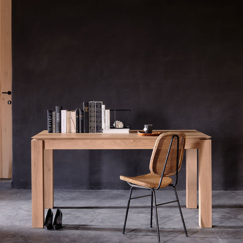 Oak-Planar-Dining-Table-Lifestyle styled with books and a chair as a desk in a modern home office