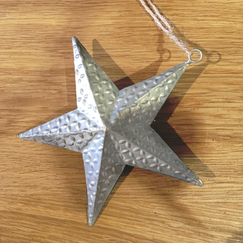 dark pewter silver metal 5 point star with raised pattern.