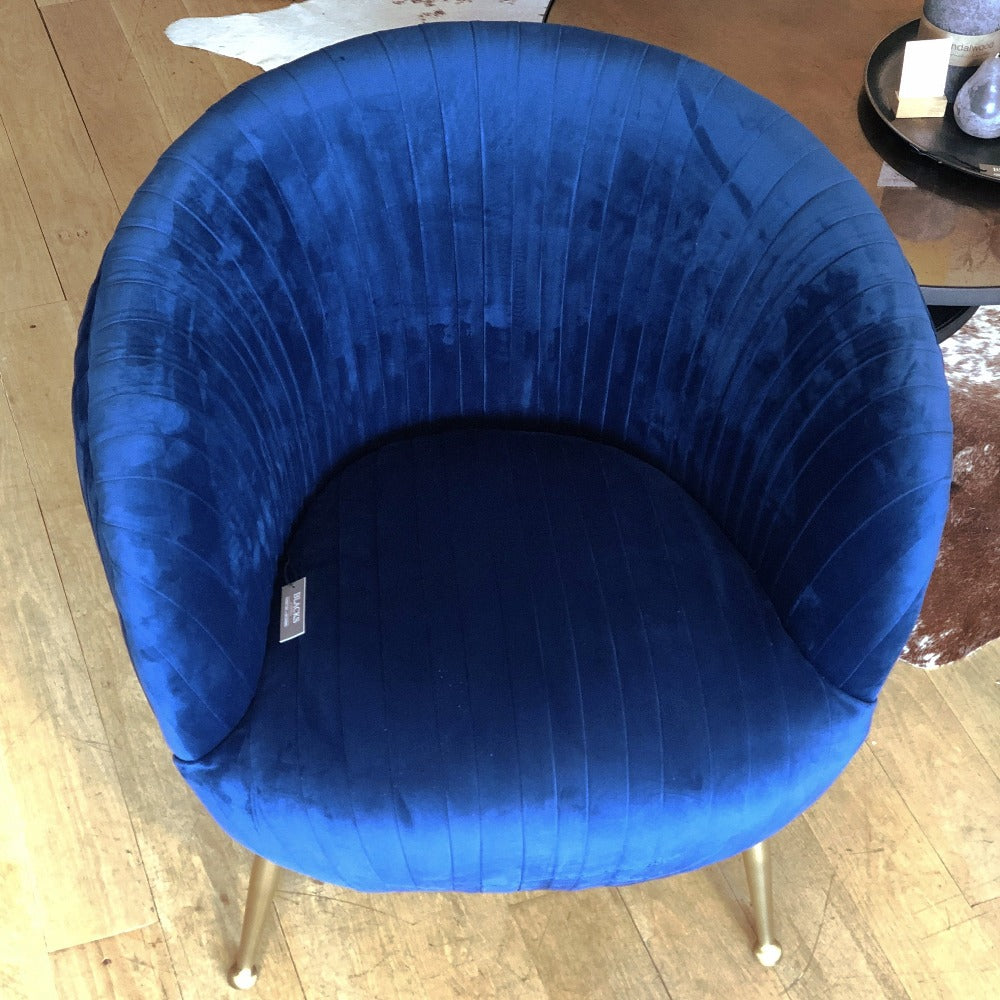 cobalt blue tub chair covered front and back with pleated velvet- front view of deep seat