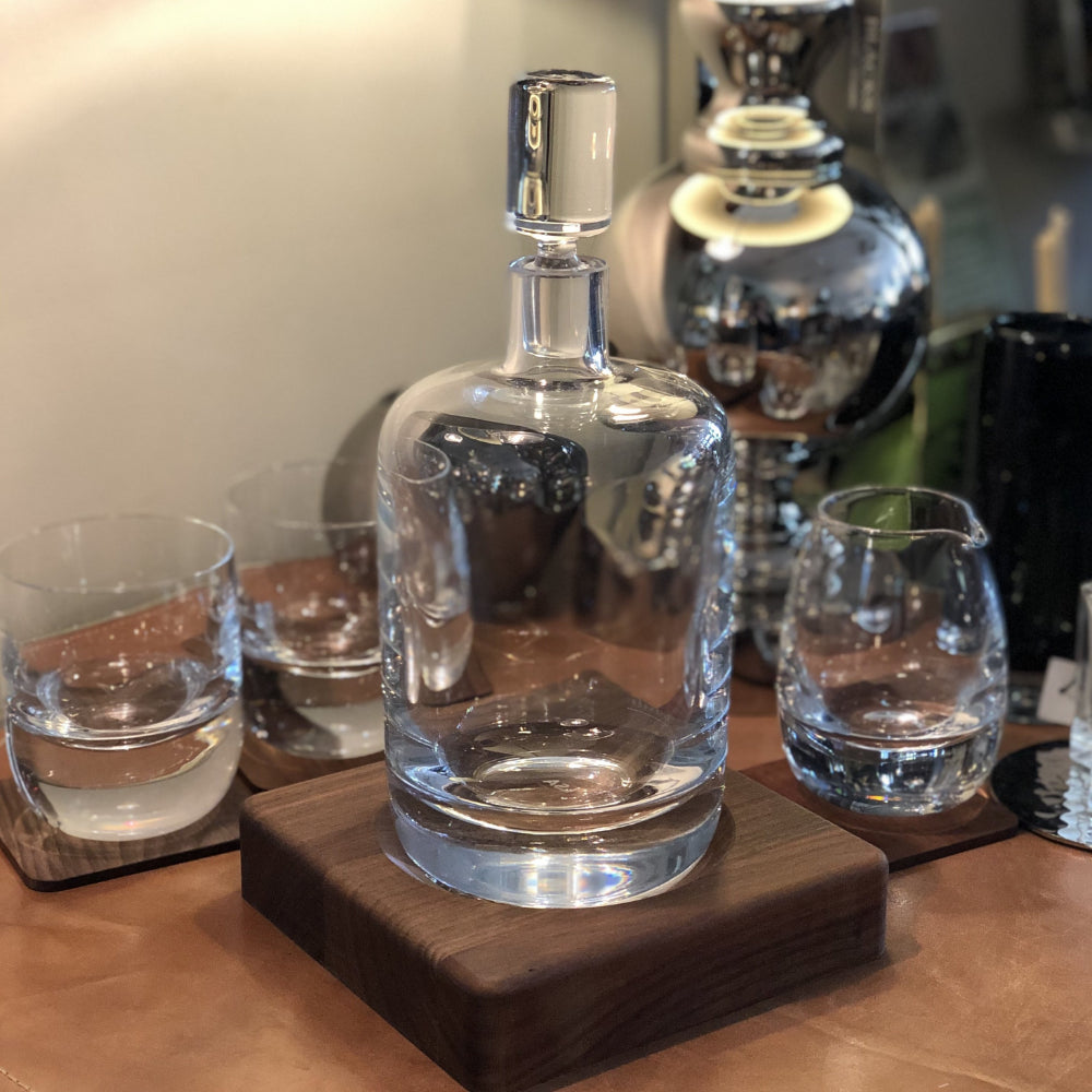 glass whisky decanter nestled in shaped walnut base