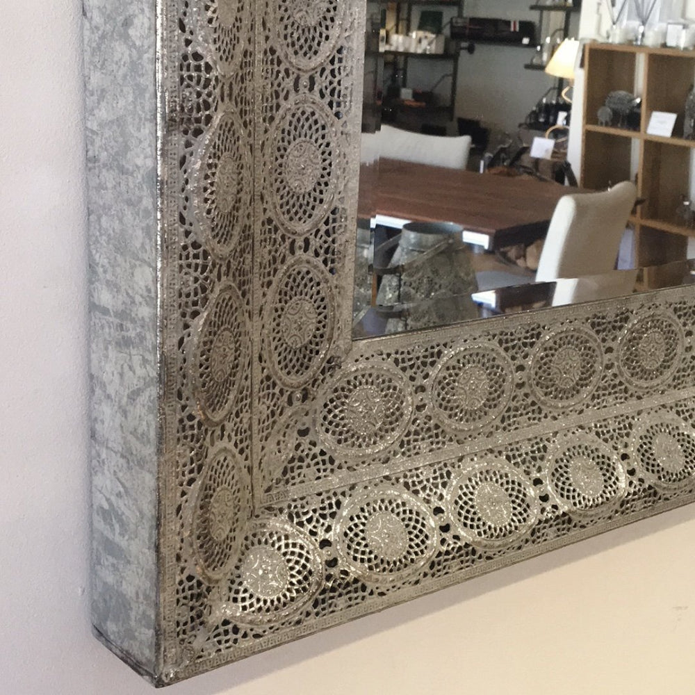 maura mirror detail showing blue/ grey / verdigris colour metal frame.