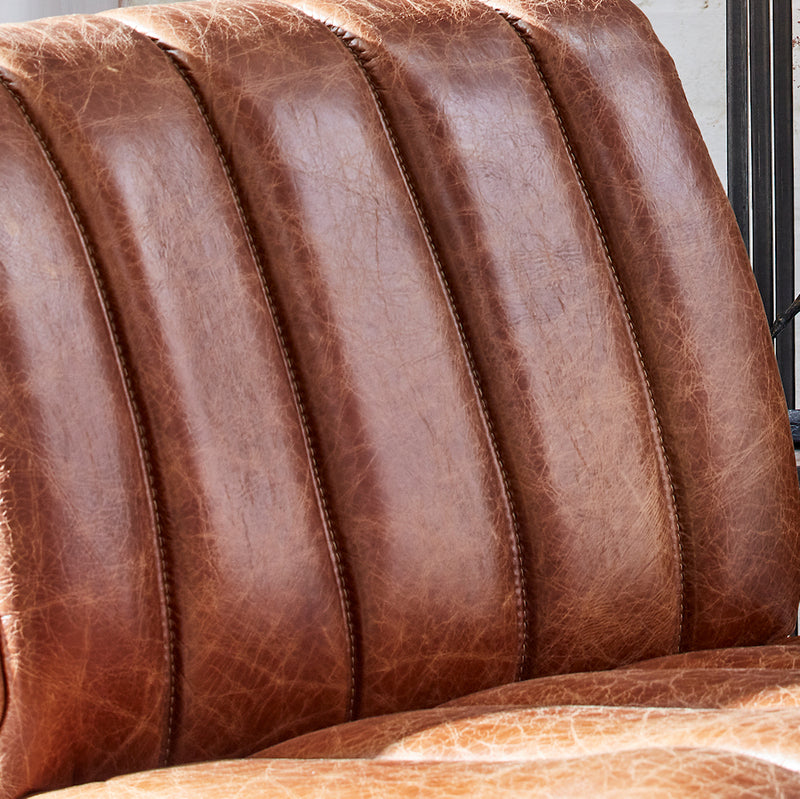 Nurburg chair detail showing aged and distressed leather