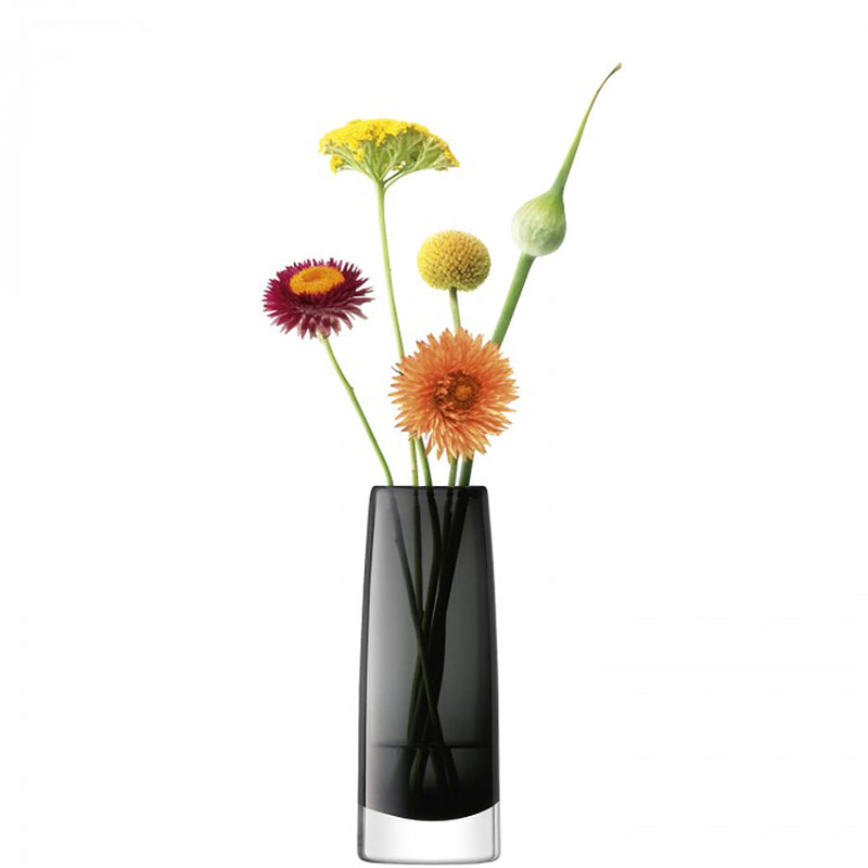 dark grey glass bud vase, sightly tapered at top, with 5 individual stems in.